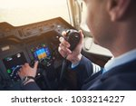 close up pilot hand taking by... | Shutterstock . vector #1033214227