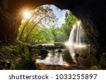 cave in heo suwat waterfall... | Shutterstock . vector #1033255897