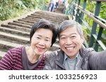 old couple selfie happily in... | Shutterstock . vector #1033256923