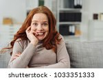 young redhead woman with a look ... | Shutterstock . vector #1033351333