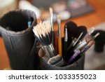 makeup brushes in a  cup. | Shutterstock . vector #1033355023