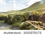 female tourist hiker visiting... | Shutterstock . vector #1033370173