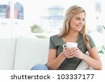 a woman smiling as she holds a... | Shutterstock . vector #103337177