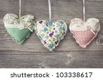 colorful hearts on wooden... | Shutterstock . vector #103338617
