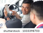 driver showing the direction to ... | Shutterstock . vector #1033398703