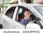 young handsome male using... | Shutterstock . vector #1033399933