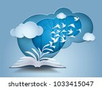 open book with bird flying from ... | Shutterstock .eps vector #1033415047