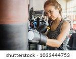 young asian sport woman wearing ... | Shutterstock . vector #1033444753
