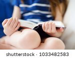 adorable little girl reading a... | Shutterstock . vector #1033482583