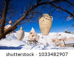 clay jugs hanging in a line in... | Shutterstock . vector #1033482907