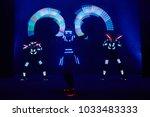 laser show performance  dancers ... | Shutterstock . vector #1033483333