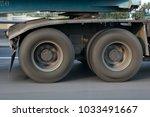 a spinning wheel of a truck... | Shutterstock . vector #1033491667