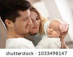 young parents with baby at home | Shutterstock . vector #1033498147