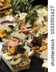 forest mushrooms on the market | Shutterstock . vector #1033501627