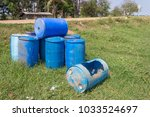 bin many blue tanks on grass. | Shutterstock . vector #1033524697