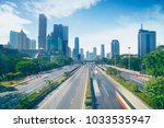 aerial view of busy highway... | Shutterstock . vector #1033535947