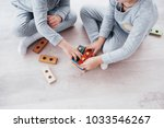 children play with a toy... | Shutterstock . vector #1033546267