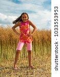 happy little girl in a field  ...   Shutterstock . vector #1033553953
