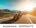 motorcycle driver riding... | Shutterstock . vector #1033556173