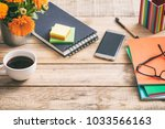 wooden desktop with notepad and ... | Shutterstock . vector #1033566163