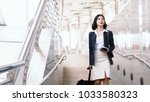 asian female traveler looking...   Shutterstock . vector #1033580323
