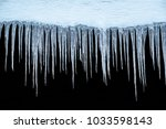 icicles on an black background  ... | Shutterstock . vector #1033598143