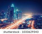spectacular nighttime skyline... | Shutterstock . vector #1033629343