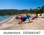 group of people doing sport... | Shutterstock . vector #1033661467