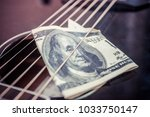 play for money with guitar and... | Shutterstock . vector #1033750147