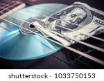 play for money with guitar and... | Shutterstock . vector #1033750153