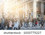 anonymous people crossing... | Shutterstock . vector #1033775227