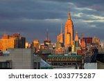 sunlight glows on the buildings ... | Shutterstock . vector #1033775287