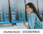 happy asian woman using... | Shutterstock . vector #1033805803
