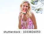 portrait of beautiful woman on... | Shutterstock . vector #1033826053