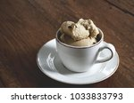 white coffee cup filled with... | Shutterstock . vector #1033833793