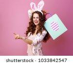 festive bunny and eggs season....   Shutterstock . vector #1033842547