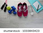 fitness concept with sneakers... | Shutterstock . vector #1033843423