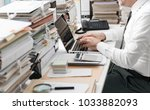 business executive working in... | Shutterstock . vector #1033882093