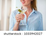 woman holding glass with... | Shutterstock . vector #1033942027