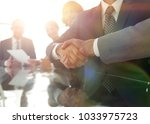 handshake business partners at... | Shutterstock . vector #1033975723
