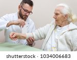doctor with a beard and glasses ... | Shutterstock . vector #1034006683