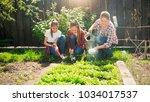 two teenage girls weeding...   Shutterstock . vector #1034017537