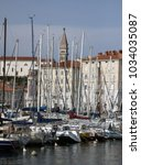Small photo of Piran, Slovenia - August 28, 2017: Leisure boats and fisherboats in the small harbor of Piran at the Adriatic sea