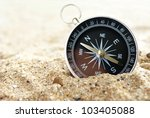 compass on the sea sand and place for text - stock photo