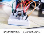 breadboard connected to arduino.... | Shutterstock . vector #1034056543