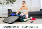 beautiful woman getting ready... | Shutterstock . vector #1034059213