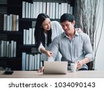 couple working with laptop... | Shutterstock . vector #1034090143