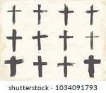 grunge hand drawn cross symbols ... | Shutterstock . vector #1034091793