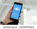 hand using smart phone with... | Shutterstock . vector #1034093563