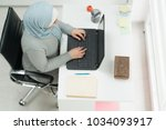 young muslim girl wotking on... | Shutterstock . vector #1034093917